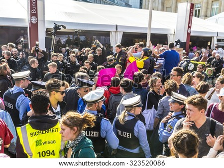 FRANKFURT, GERMANY - OCT 3, 2015: People demonstrate against the celebration of 25th day of German unity in Frankfurt, Germany and for better conditions for refugees. - stock photo