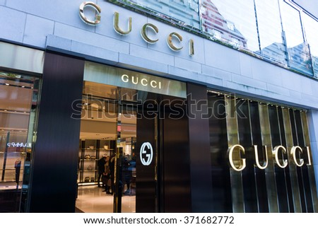FRANKFURT, GERMANY - OKTOBER 24, 2015:  Gucci signage at store entrance. Gucci is an Italian fashion label owned by French company PPR. Gucci was founded by Guccio Gucci in Florence in 1921