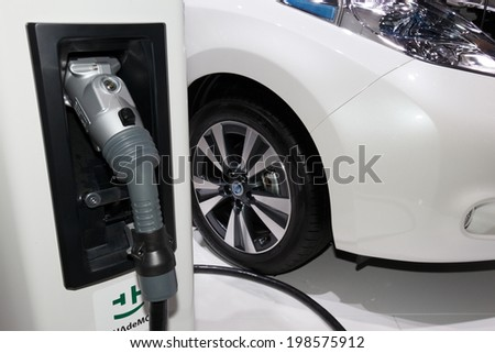 FRANKFURT, GERMANY - SEP 20: Nissan Leaf and Charger at the IAA motor show on Sep 20, 2013 in Frankfurt. More than 1.000 exhibitors from 35 countries are present at the world's largest motor show.  - stock photo