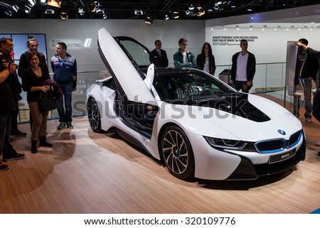 FRANKFURT, GERMANY - SEP 22: Visitors are watching the BMW i8 electric sports car at the IAA International Motor Show 2015. September 22, 2015 in Frankfurt Main, Germany