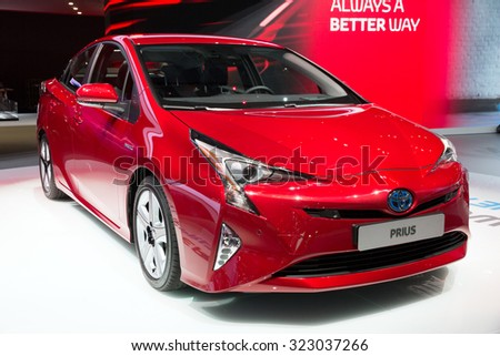 FRANKFURT, GERMANY - SEP 16, 2015: World premiere of the new Toyota Prius Hybrid car at the IAA 2015. - stock photo