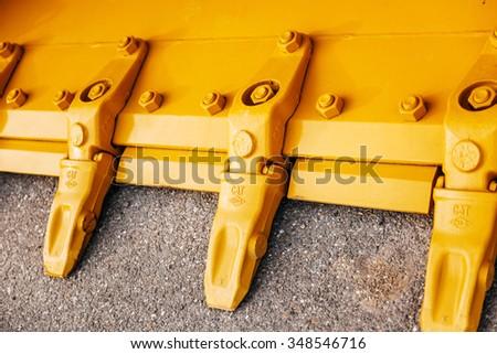 FRANKFURT, GERMANY - SEPT 05, 2015: Standard rock mass excavation bucket mining showel steel teethes of a new CAT Caterpillar industrial excavator - stock photo