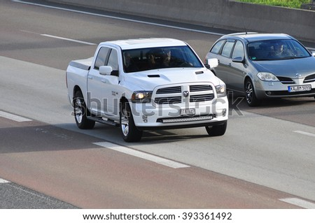 FRANKFURT,GERMANY - SEPT 24:white SUV on the highway on September 24,2015 in Frankfurt, Germany. - stock photo