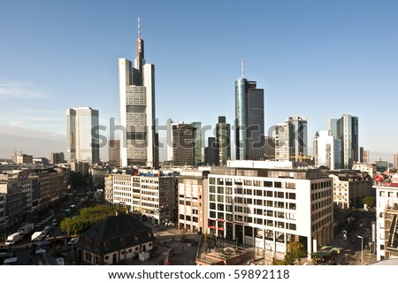 FRANKFURT, GERMANY - SEPTEMBER 10: view to skyline of Frankfurt with Hauptwache and skyscraper early morning on September 10,2009 Frankfurt,Germany - stock photo
