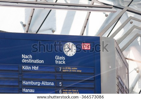 FRANKFURT, GERMANY - SEPTEMBER 14, 2009: Vintage train information boarding board at Frankfurt Airport Train station with clock and information. - stock photo