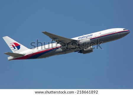 FRANKFURT - JUNE 19: A Malaysia Airlines Boeing 777 takes off on June 19, 2013 in Frankfurt, Germany. The aircraft is the sister airplane of the crashed planes with the registration 9M-MRO and 9M-MRD. - stock photo