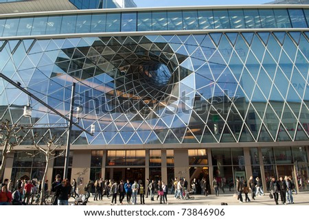 FRANKFURT - MARCH 22: Pedestrians walk outside the shopping center Myzeil on March, 22, 2011 in Frankfurt, Germany. The modern facade was designed by architect M. Fuksas.