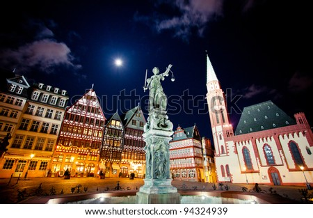 Frankfurt old city. Lady justice on the Roemer place - stock photo