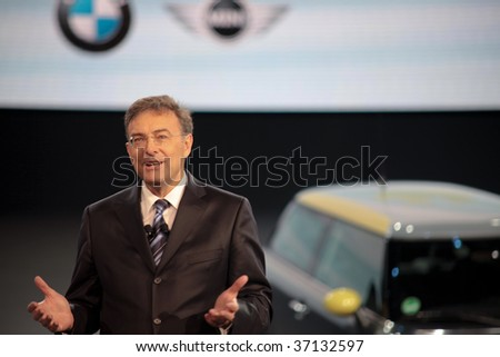 FRANKFURT - SEP 15: BMW Chairman Dr. Norbert Reithofer with a Mini in the background during a press conference on 63rd IAA (Internationale Automobil Ausstellung) on September 15, 2009 in Frankfurt, Germany.