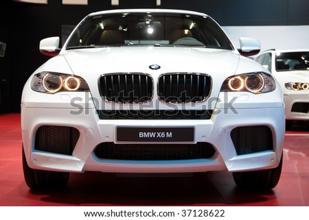 FRANKFURT - SEP 15: White BMW X6 M in front view on 63rd IAA (Internationale Automobil Ausstellung) on September 15, 2009 in Frankfurt, Germany. - stock photo