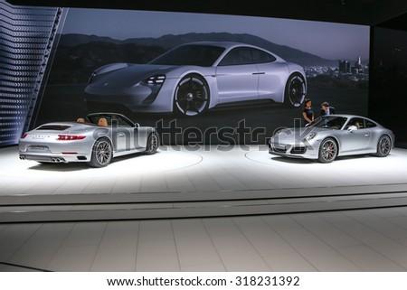 FRANKFURT - SEPT 16: Porsche 911 Carrera S Cabrio and 911 Carrera S shown at the 66th IAA (Internationale Automobil Ausstellung) on September 16, 2015 in Frankfurt, Germany. - stock photo