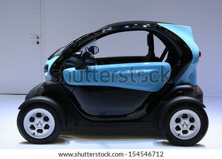FRANKFURT - SEPT 10: Renault ZE Twizy shown at the 65th IAA (Internationale Automobil Ausstellung) on September 10, 2013 in Frankfurt, Germany. - stock photo
