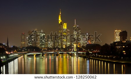 Frankfurt Skyline Panorama at Night reflecting in the Main River, Germany. - stock photo