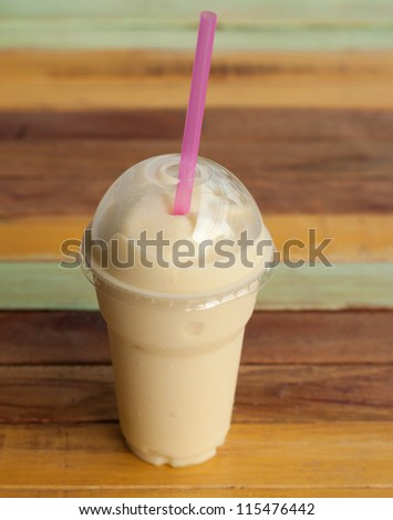 frappe coffee on wood table - stock photo
