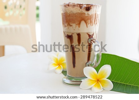 Frappe Iced Coffee Drink with plumeria - stock photo