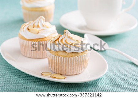 Frappuccino in a glass with whipped cream and almond milk - stock photo