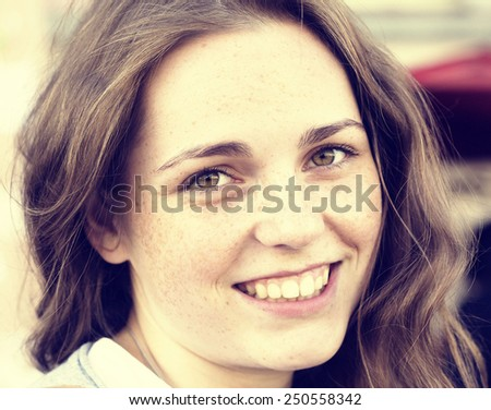 freckled hipster young beautiful woman street outdoor portrait with beautiful eyes  - stock photo