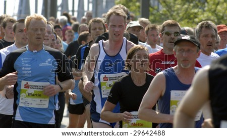 FREDERICIA - MAY 2: People all over running Little Belt Half Marathon from Middelfart to Fredericia. Crossing the Old Little Belt Bridge. 2nd of May, 2009, Denmark. - stock photo