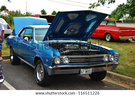 FREDERICK, MD- SEPTEMBER 16: 1967 Blue Chevy SS 396 on Sept. 16, 2012 in Frederick , MD USA. Alzheimer's Association Benefit Car Show at Motor Vehicle Administration in Maryland. - stock photo