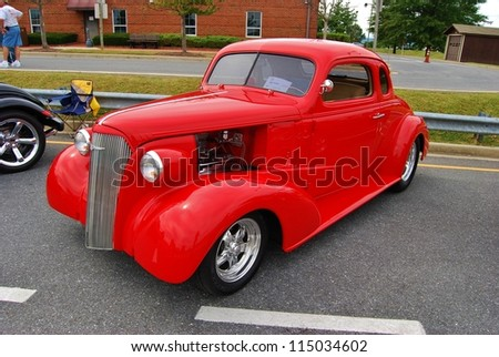 FREDERICK, MD- SEPTEMBER 16: 1941 Red Chevrolet 2 Door on Sept. 16, 2012 in Frederick , MD USA. Alzheimer's Association Benefit Car Show at Motor Vehicle Administration in Maryland. - stock photo