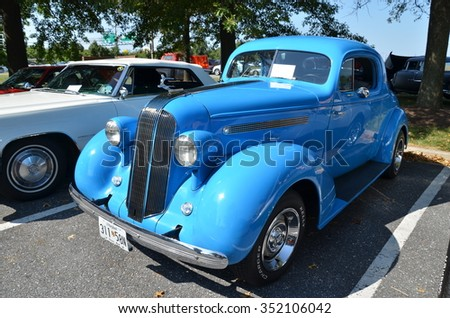 FREDERICK, MD- SEPTEMBER 16: Vintage Cars ,and Truck at a Car Show on September, 2015 in Frederick , MD USA. Alzheimer's Association Benefit Car Show at Motor Vehicle Administration in Maryland. - stock photo