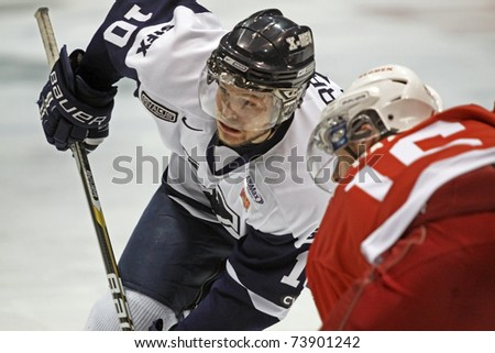FREDERICTON, CANADA - MARCH 24: Brett Morrison of St. FX faces off against McGill at the 2011 CIS men's hockey championship tournament on March 24, 2011 in Fredericton, Canada. - stock photo