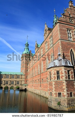 Frederiksborg castle and canal, the largest Renaissance palace in Denmark and Scandinavia - stock photo