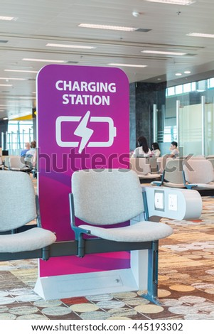 Free charging station in airport. - stock photo