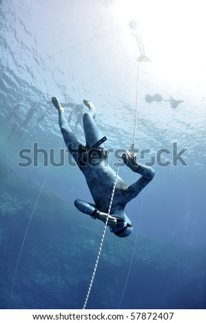 Free diver makes preparation dive near the safety line by breaststroke. Picture shows a part of free diving training session in Blue Hole, Dahab, Egypt