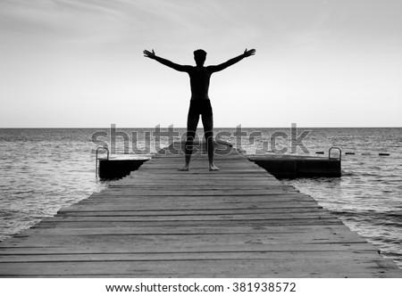 Free happy man enjoying life in nature - stock photo