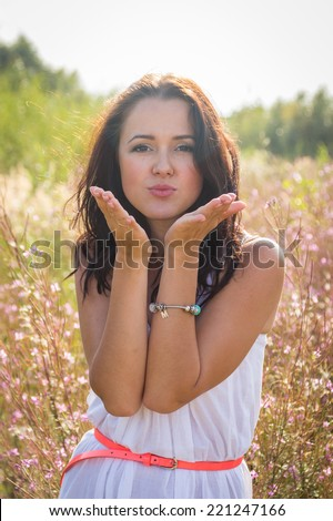 Free Happy Woman Enjoying Nature. Beauty Girl Outdoor. Freedom concept. Beauty Girl in the field. Enjoyment.Portrait of the young beautiful smiling woman outdoors.A beautiful girl enjoying summer sun - stock photo