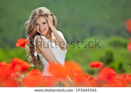 Free Happy Woman Enjoying Nature. Beauty Girl Outdoor. Freedom concept. Beauty Girl over Sky and Sun. Sunbeams. Enjoyment. - stock photo