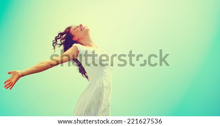Free Happy Woman Enjoying Nature. Beauty Girl Outdoor. Freedom concept. Beauty Healthy Girl over Sky and Sun. Enjoyment - stock photo