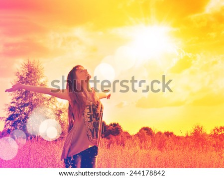 Free happy woman enjoying nature sunset. Beauty girl outdoor. Freedom concept.  Girl over sky and sun.  Enjoyment. - stock photo