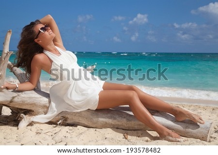 Free happy woman in white summer dress enjoying nature on the exotic beach. Beauty girl outdoor. Freedom concept. - stock photo