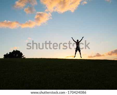 Free happy young man enjoying nature. Freedom concept. - stock photo
