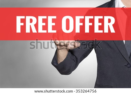 Free Offer word Business man touching on red tab virtual screen for business concept - stock photo