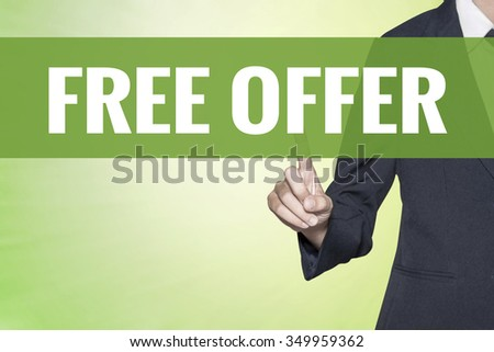 Free Offer word on vintage green virtual screen touching by business woman - stock photo