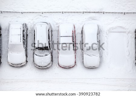 Free parking place is in line of vehicles, winter time, view from above
