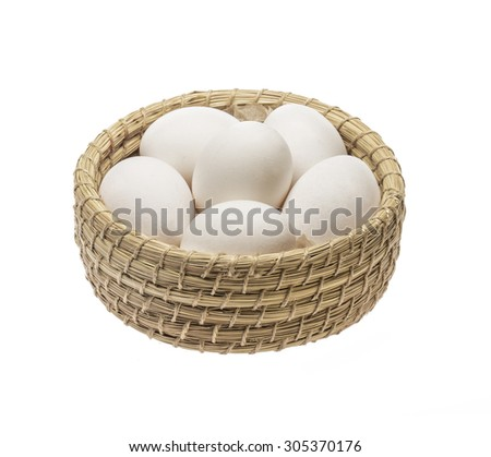 Free range white chicken eggs in wicker basket isolated on white - stock photo