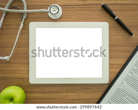 free space for text in tablet computer on desk's doctor. top view - stock photo