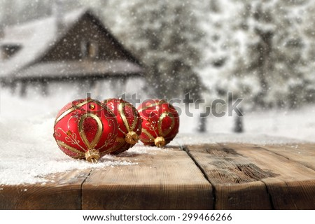 free space for your decoration and wooden board of snow and blurred background  - stock photo