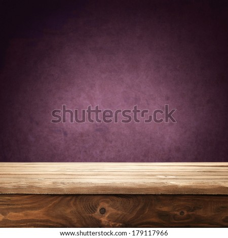free space on desk and wall of red  - stock photo