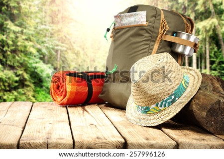 free space on table and hat with backpack  - stock photo