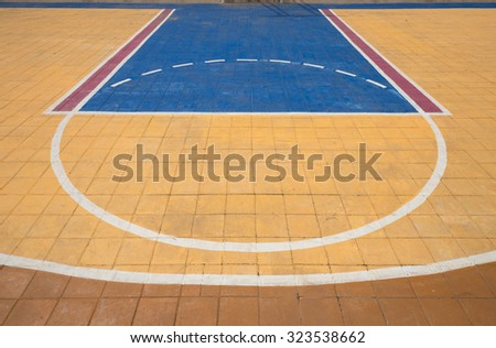 Free throw lines of the public outdoor basketball court - stock photo
