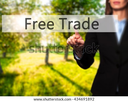 Free Trade - Businesswoman hand pressing button on touch screen interface. Business, technology, internet concept. Stock Photo - stock photo