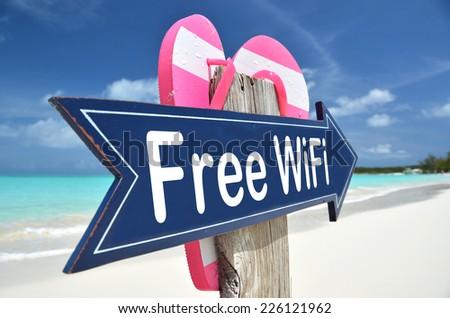 Free WiFi arrow on the beach - stock photo