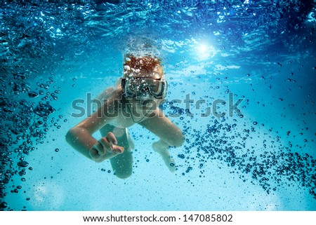 Freedive. Teenager in the mask and snorkel swim underwater. - stock photo