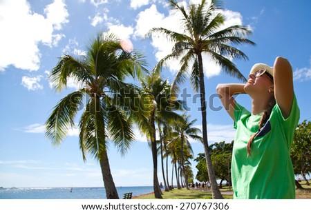 Freedom beach woman. Happy young woman meditation enjoying summer sun and tanning during holidays on Hawaii. Summer luxury vacation. Hawaiian Island of Oahu - stock photo