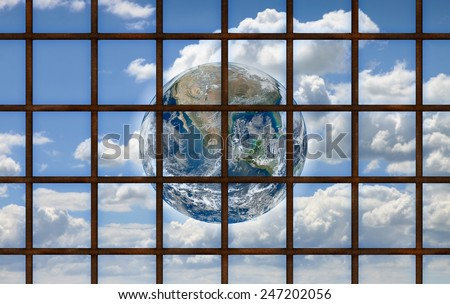 Freedom concept: the world through a grating Concept with image from NASA. - stock photo